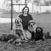 Janelle Haggett and four golden retrievers