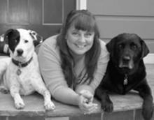 Lynette Bunyard surrounded by her two large dogs