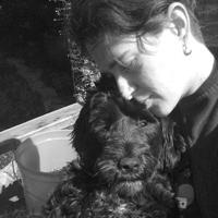 Miki Merin snuggles a sweet pup